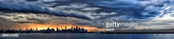 sunset over sydney austalia - sydney rain stock pictures, royalty-free photos & images