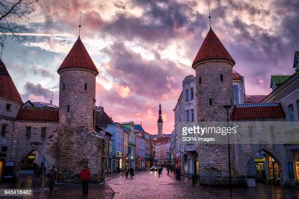 TOWN TALLINN HARJUMAA ESTONIA Sunset over Tallinn old town The barbican of Viru Gate was part of the defence system of Tallinn city wall built in the...