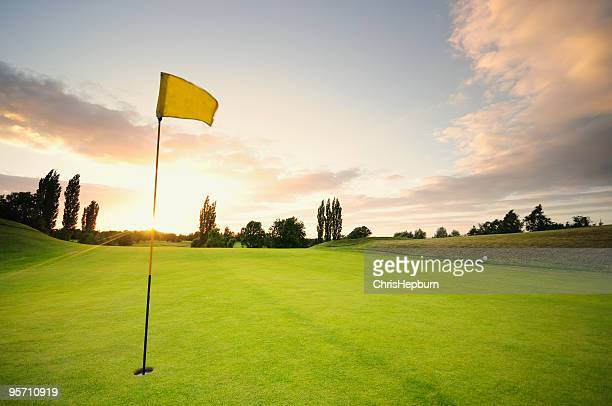 sunset over the 18th - golf flag stock photos and pictures