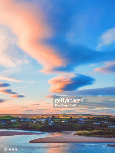 sunset over the bay - sunset stock pictures, royalty-free photos & images