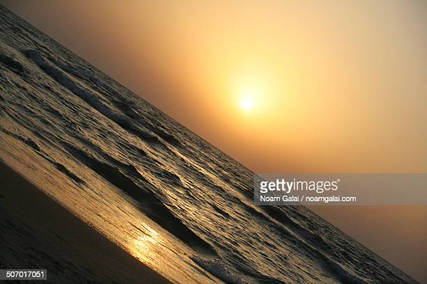 sunset over the beach - noam galai stock pictures, royalty-free photos & images