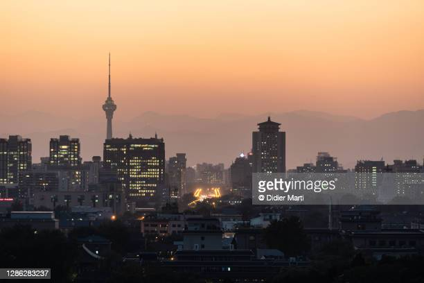 sunset over the beijing skyline, china capital city - beijing stock pictures, royalty-free photos & images