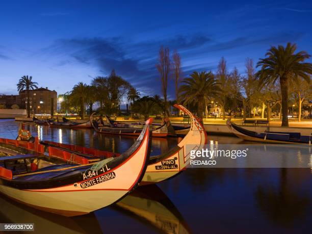Sunset over the Canal Central with the traditional Moliceiro Boats. Aveiro in Because of the many channels Aveiro is called the Venice of Portugal....