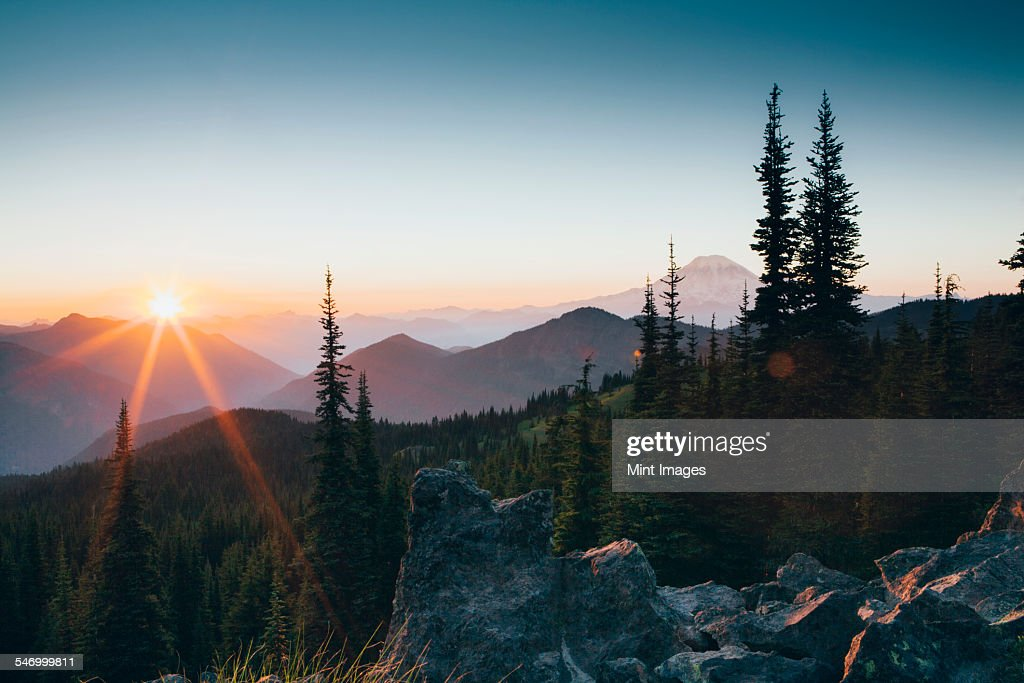 Sunset over the Cascade Range of mountains at Goat Rocks Wilderness. : Stock Photo