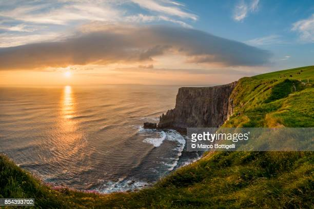 Sunset over the Cliffs of Moher, Ireland.