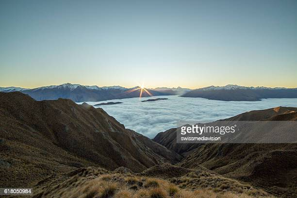 Sunset over the clouds, mountain landscape