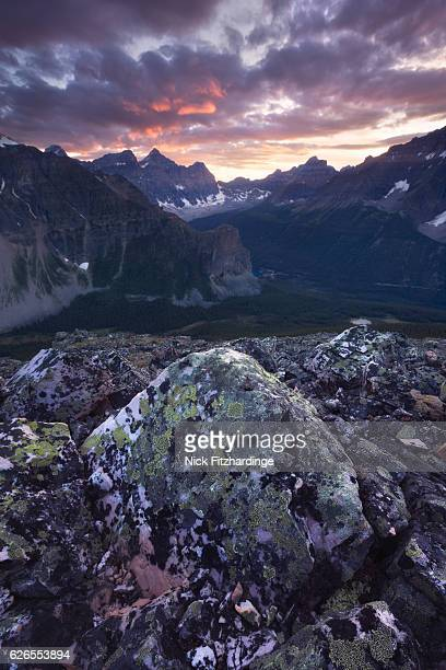 Sunset over the continental divide and a lichen covered rock viewed from Panorama Ridge, Banff National Park, Alberta, Canada