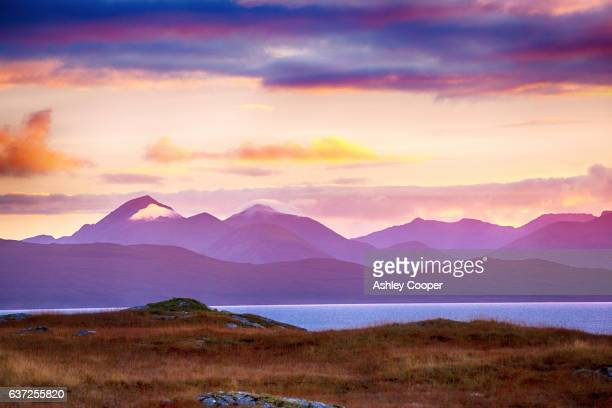 Sunset over the Cuillins and Red Cuillin Hills on the Isle of skye from Applecross, Scotland, UK.