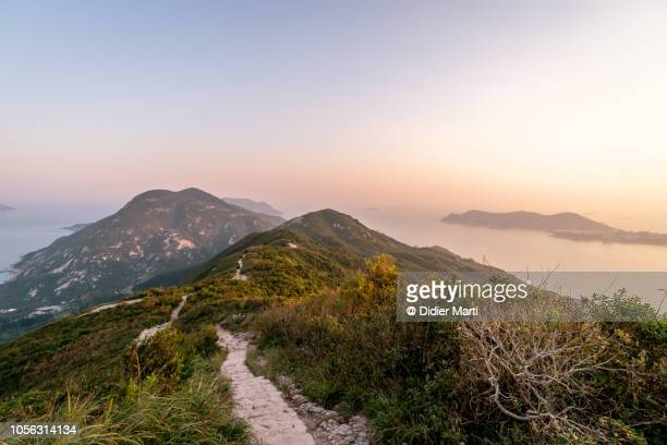 sunset over the dragon's back hiking trail in hong kong - ridge stock pictures, royalty-free photos & images