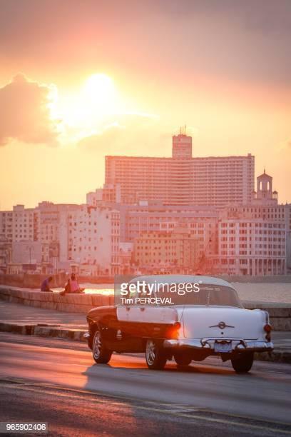 Sunset over the Edificio Focsa and Pontiac by the Malecon Havana