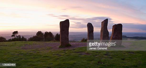 sunset over the four stones at the highest point of the clent hills near birmingham. - birmingham england stock pictures, royalty-free photos & images