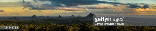 sunset over the glass house mountains - glass house mountains stock pictures, royalty-free photos & images