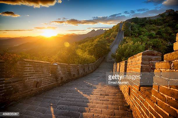 sunset over the great wall of china - great wall of china stock pictures, royalty-free photos & images