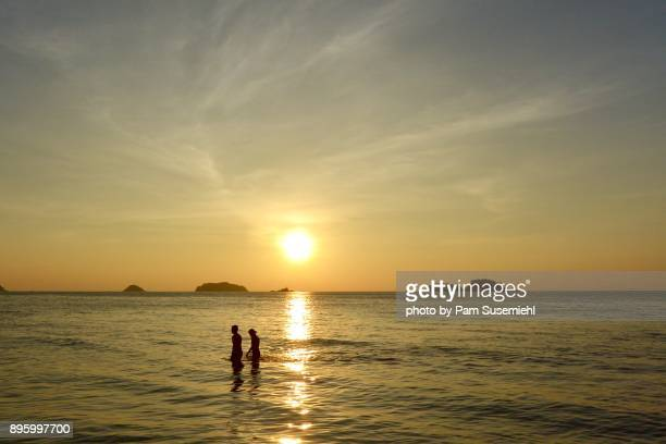 sunset over the gulf of thailand - wispy stock photos and pictures