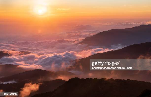 sunset over the highlands of costa rica - christopher jimenez nature photo stock pictures, royalty-free photos & images