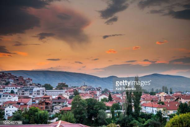 sunset over the hills in town of veles, macedonia - macedonië land stockfoto's en -beelden