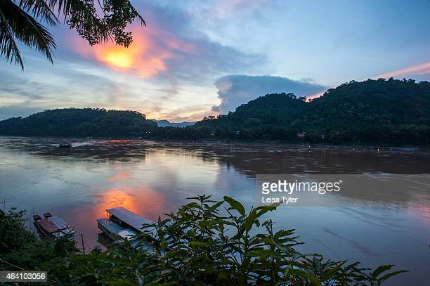 Sunset over the Mekong River from one of the tourist bars along the waterfront in Luang Prabang