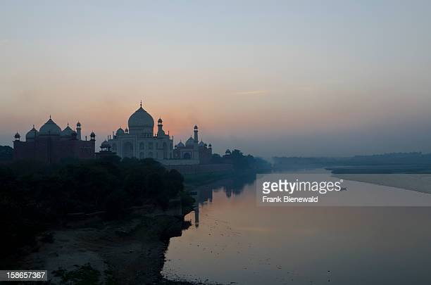 Sunset over the most beautiful building of the world the Taj Mahal located at the river Yamuna
