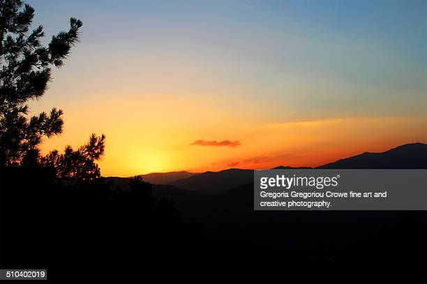 sunset over the mountains. - gregoria gregoriou crowe fine art and creative photography stock pictures, royalty-free photos & images