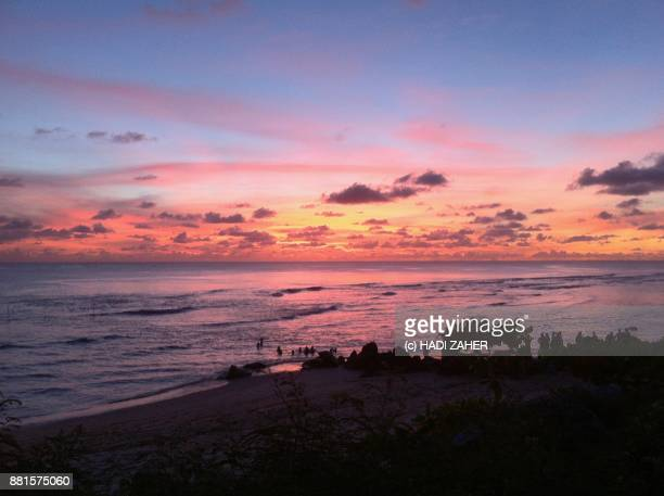 sunset over the pacific ocean | nauru - nauru stock pictures, royalty-free photos & images