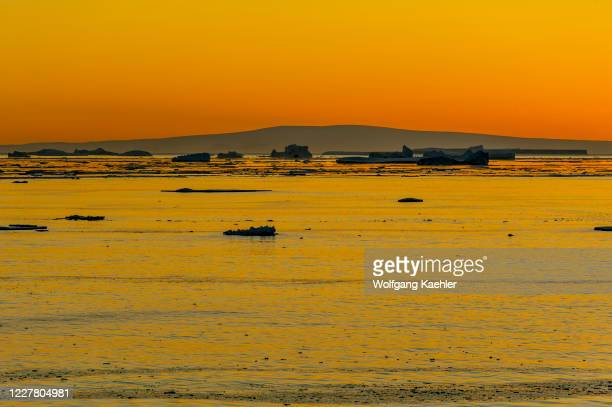 Sunset over the pack ice near Paulet Island, an island off the north-eastern end of the Antarctic Peninsula.