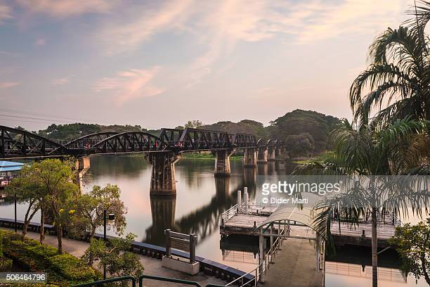 sunset over the river kwai brigde in thailand - bridge over the river kwai stock pictures, royalty-free photos & images