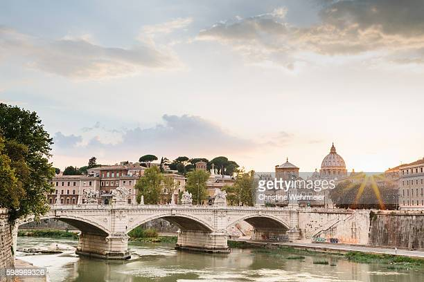 sunset over the river tiber with a view of vatican city - christine wehrmeier stock pictures, royalty-free photos & images