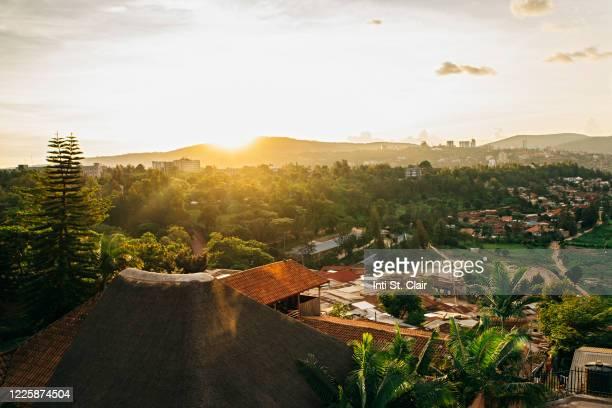 sunset over the rolling hills of kigali, rwanda - キガリ ストックフォトと画像