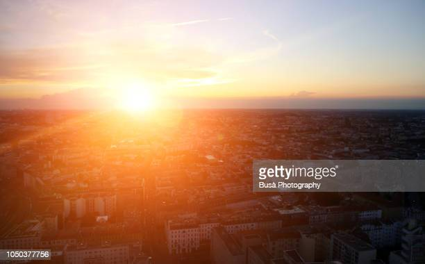 sunset over the rooftops of berlin, germany - soleggiato foto e immagini stock