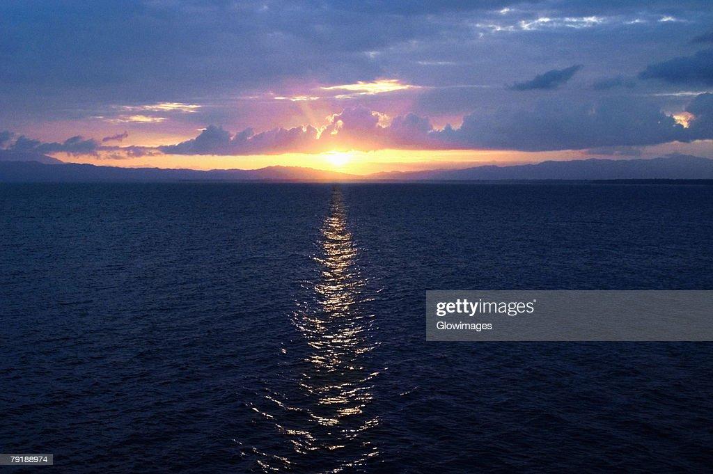 Sunset over the sea, Milne Bay, Papua New Guinea : Stock Photo