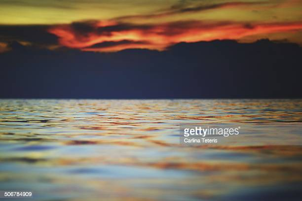 sunset over the sea - mabul island stock photos and pictures