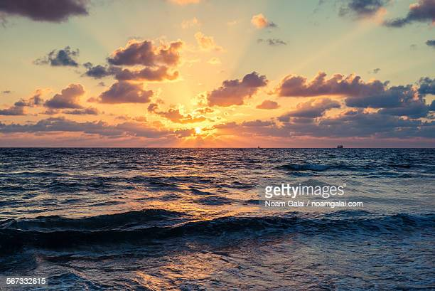 sunset over the sea - noam galai stock pictures, royalty-free photos & images