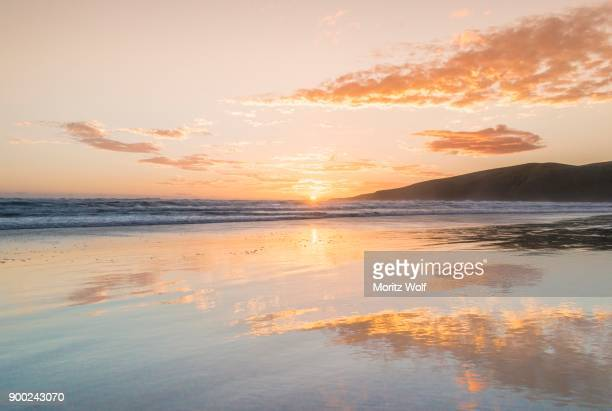 Sunset over the sea, Sandfly Bay, Dunedin, Otago Peninsula, Southland, New Zealand