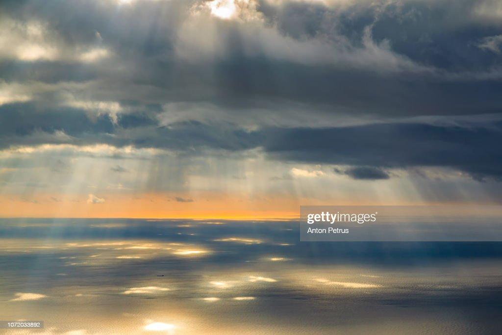 Sunset over the sea. Sunrays illuminating the sea, aerial view : Stock Photo