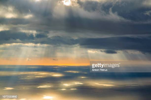 sunset over the sea. sunrays illuminating the sea, aerial view - spirituality ストックフォトと画像
