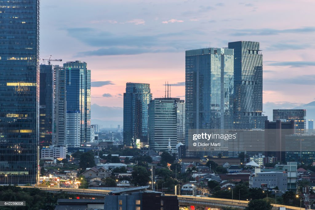 Sunset over the skyscrapers of the Jakarta business district in Indonesia capital city : Stock Photo