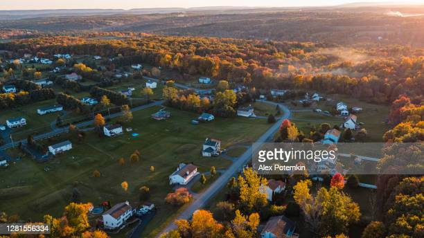 sunset over the small american town in mountains. - pennsylvania stock pictures, royalty-free photos & images