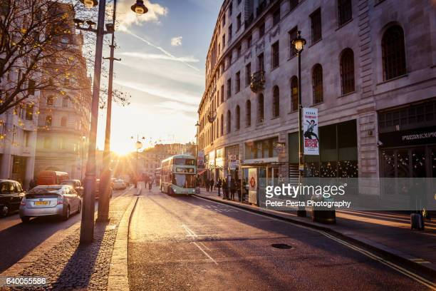 sunset over the strand street - the strand london stock pictures, royalty-free photos & images