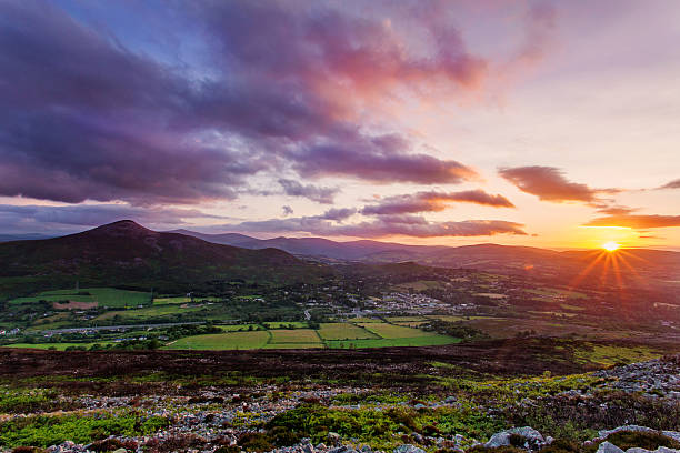 sunset over the sugarloaf mountain and Dublin