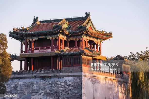 sunset over the summer palace, beijing, china. - pagoda stock pictures, royalty-free photos & images
