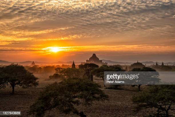 sunset over the temples of bagan, mandalay, myanmar - peter adams stock pictures, royalty-free photos & images