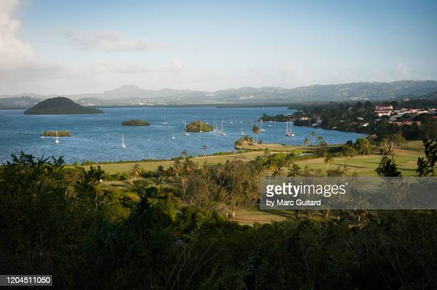 sunset over the town of trois ilets, martinique - french overseas territory stock pictures, royalty-free photos & images