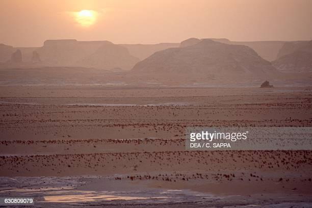 Sunset over the White desert north of the Farafra oasis Libyan desert Egypt