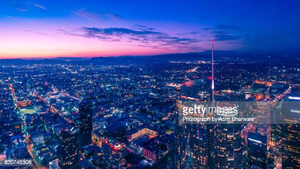 dtla sunset over the wilshire grand - beverly hills stock pictures, royalty-free photos & images