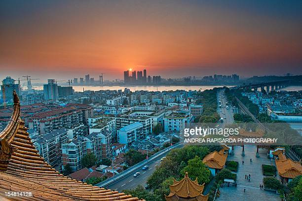 sunset over the yangtze river - wuhan stock photos and pictures