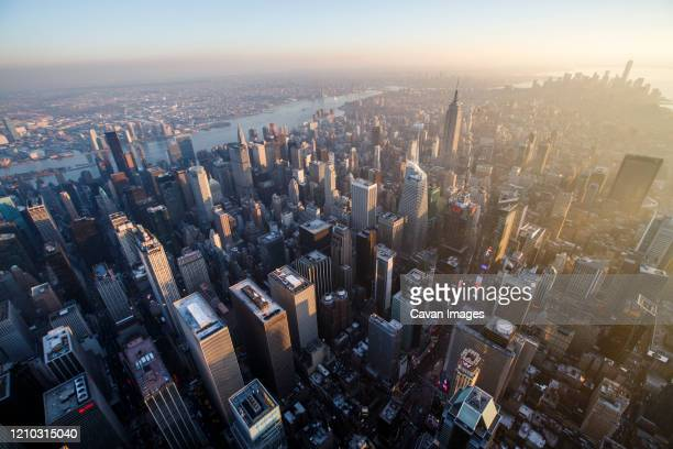 sunset over times square and midtown manhattan in new york city, ny - manhattan new york city stock pictures, royalty-free photos & images