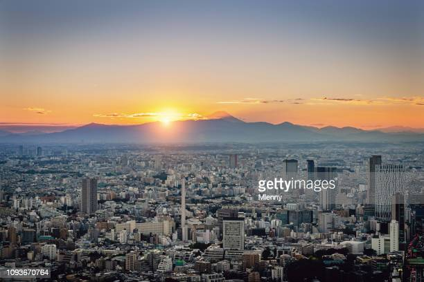 Sunset Over Tokyo Cityscape with Mount Fuji