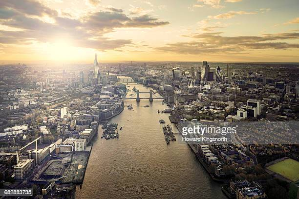 sunset over tower bridge and the thames - thames river stock pictures, royalty-free photos & images