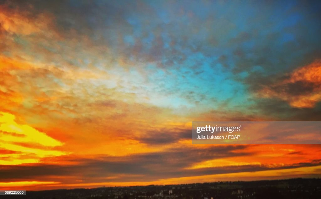 Sunset over town with dramatic sky : Stock Photo