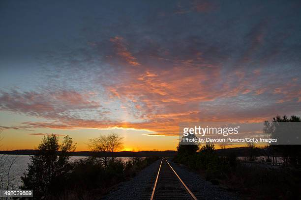 sunset over train tracks - clemson south carolina stock pictures, royalty-free photos & images